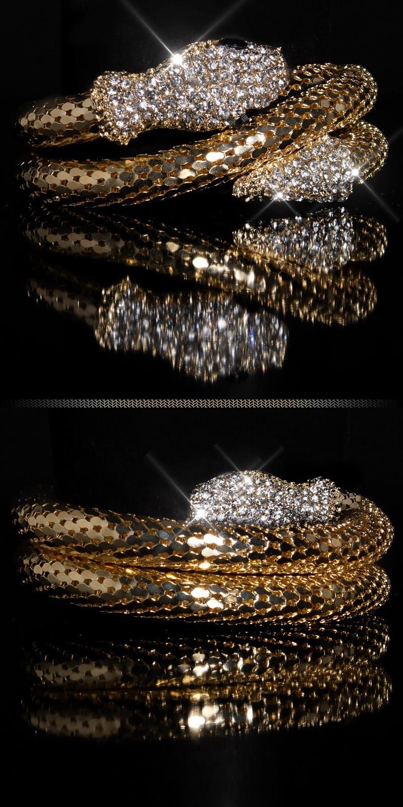 Trendy armband met slangen-print en strass steentjes goud
