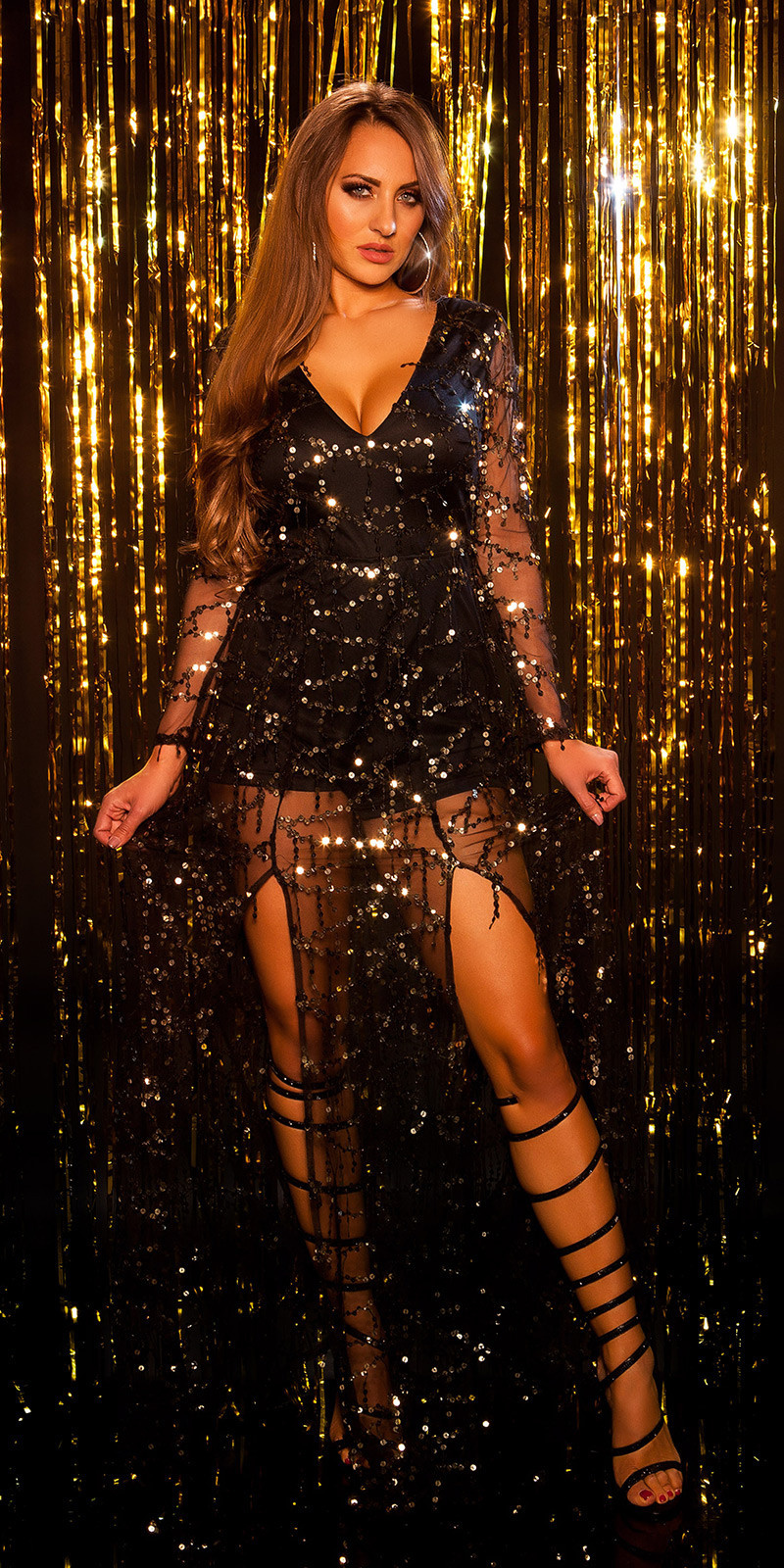 Sexy langmouw jumpsuit met pailletten franjes zwartgoud