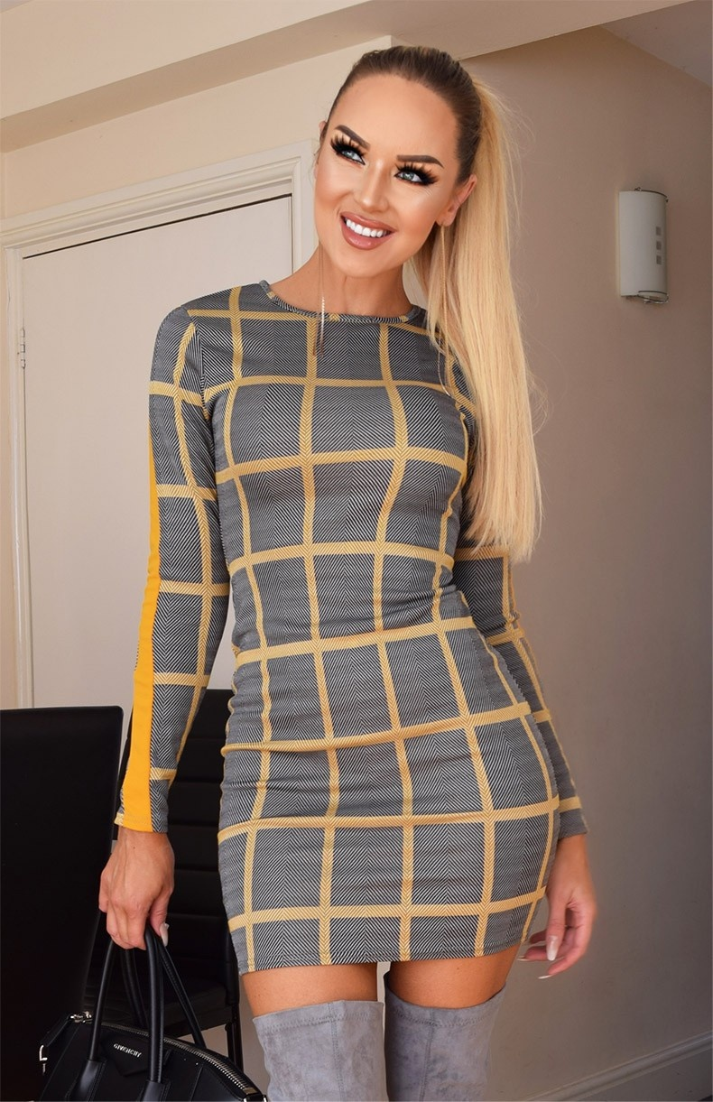 Karoline lange mouw patroon jurk mosterdgeel